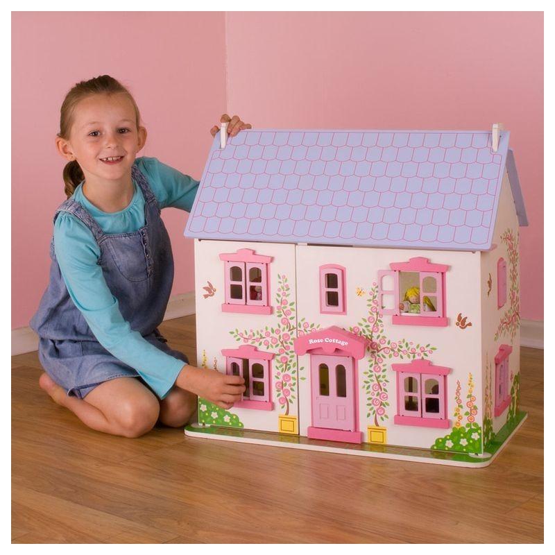 Różany drewniany domek dla lalek